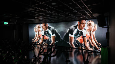 Image for IMMERSIVE FITNESS THE TRIP™ is Les Mills' premium GroupX cycling class and the most innovative fitness experience on the market. It's available at 60+ sites worldwide with 16 in the UK – 15 of which have been designed and delivered